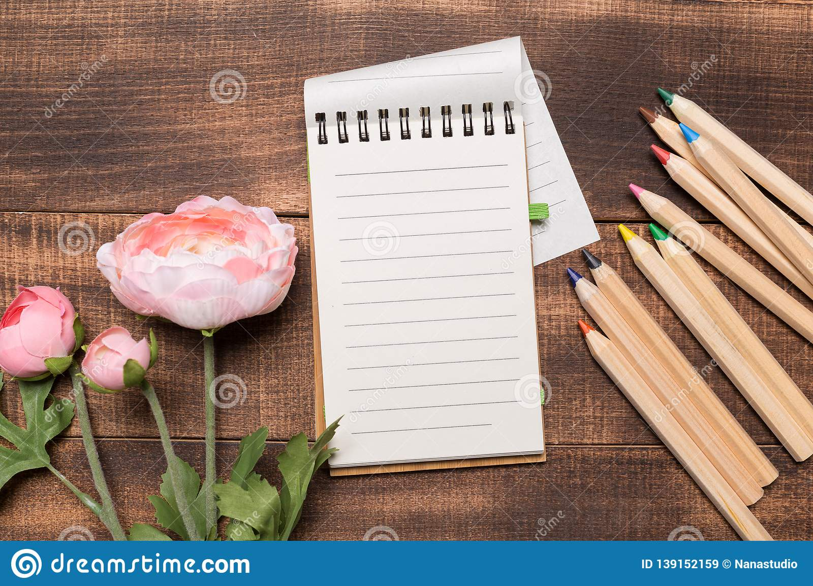 Still life, business, office supplies or education concept : Top view image of open notebook with blank pages on wood