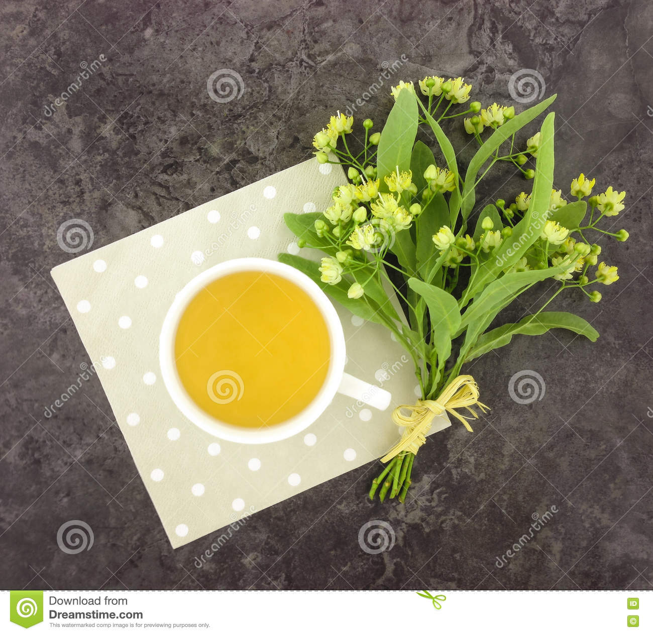 Still life with cup of tea and flower bouquet. Flat lay