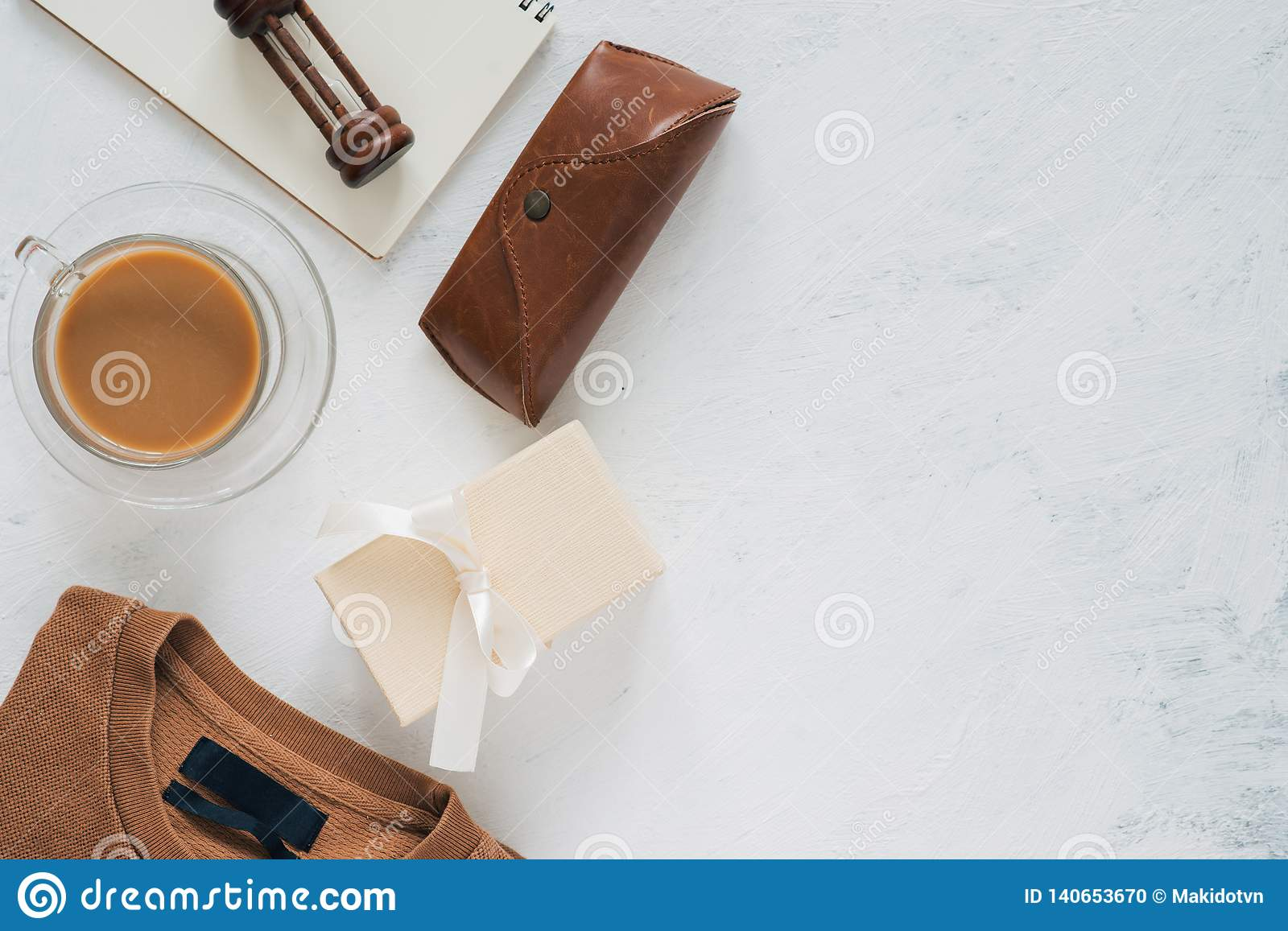 Still life, fashion, business, father`s day concept. T-Shirt and frame for father day`s greeting on white background. Selective
