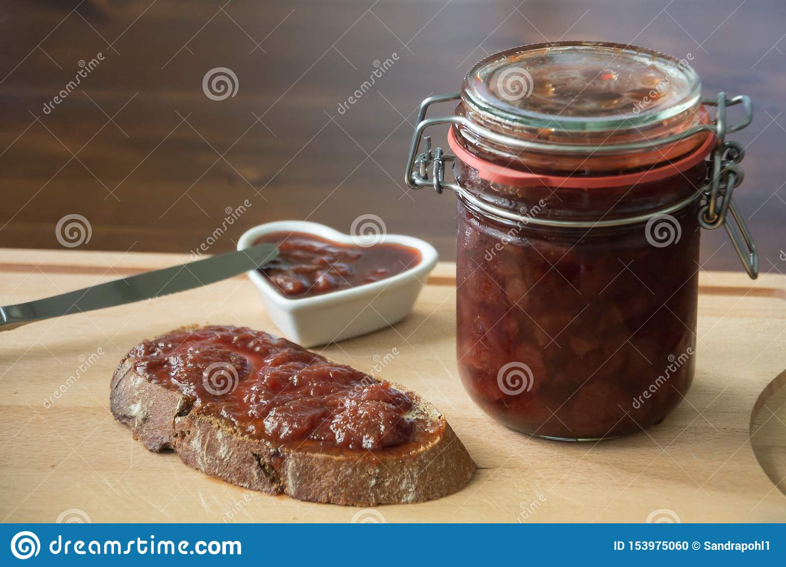 Homemade jam with bread and a knife
