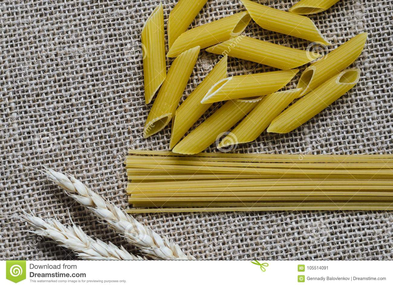 Still life for a kitchen of wheat ears and pasta from wheat on a sackcloth background Made in Kazakhstan