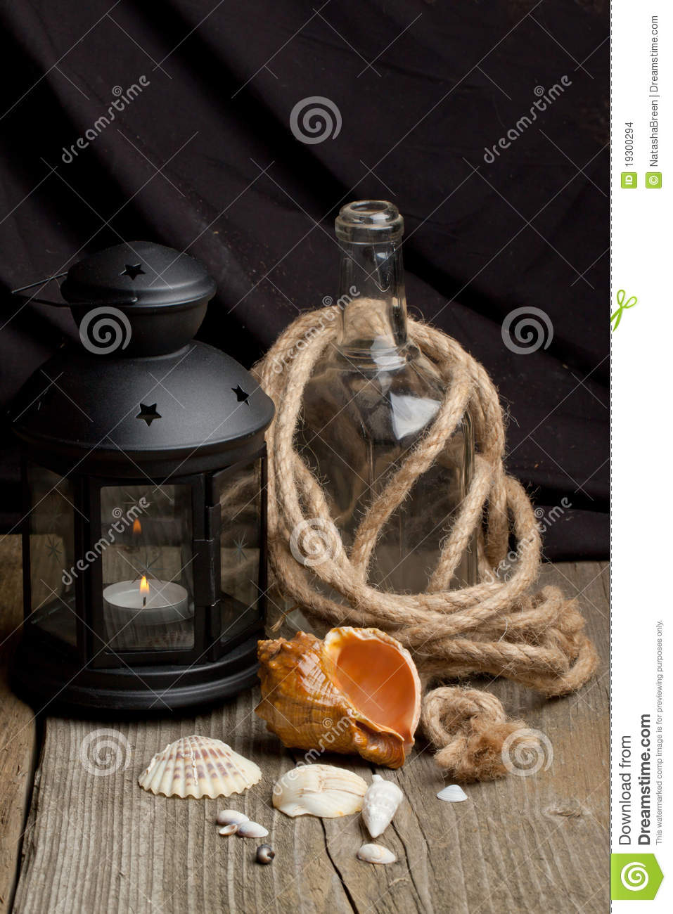 Still Life With Old Lantern Bottle And Sea Shells Stock
