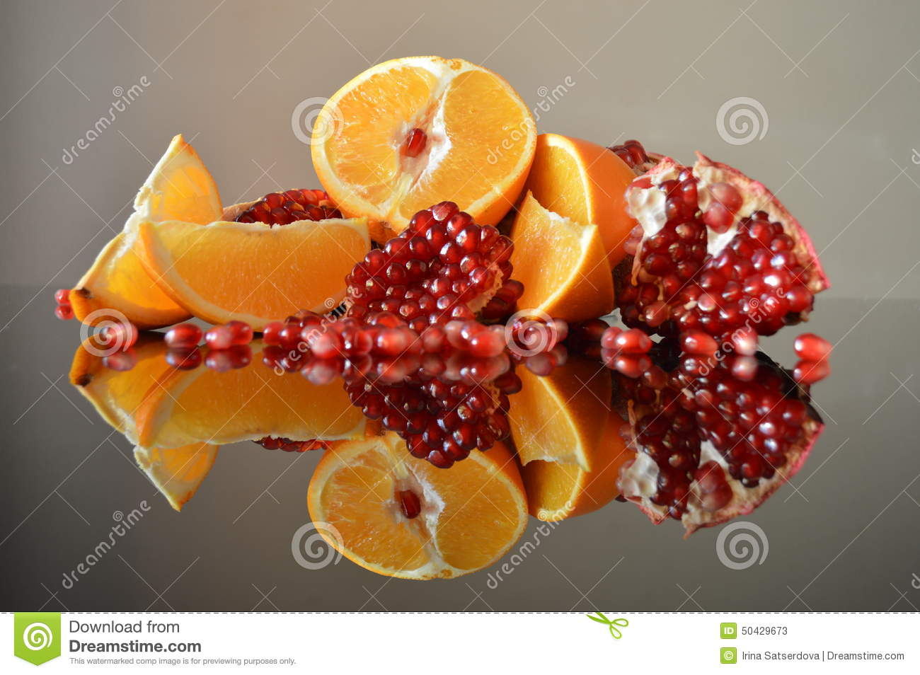 Slices of orange, pomegranate pieces, composed in the composition on a ...