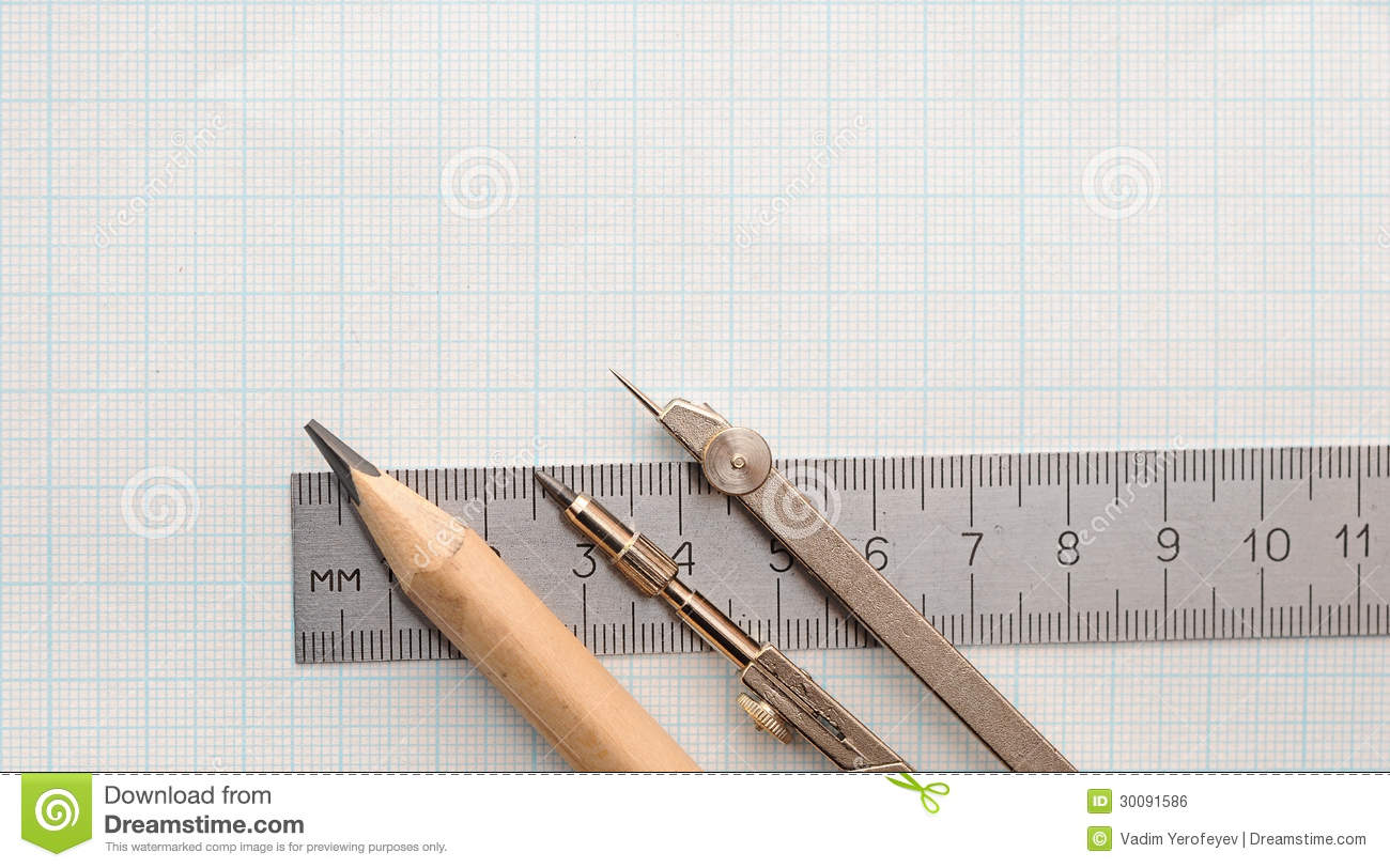 still life photo of engineering graph paper with pencil