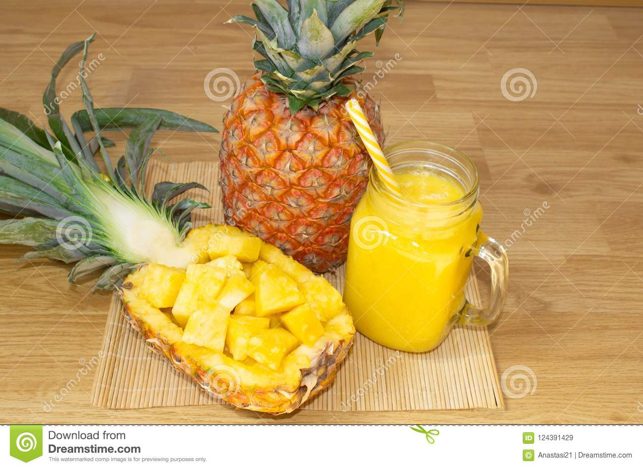 Still life. Pineapple juice, smoothies with fresh pineapple for breakfast in the morning on a wooden table. Detox.
