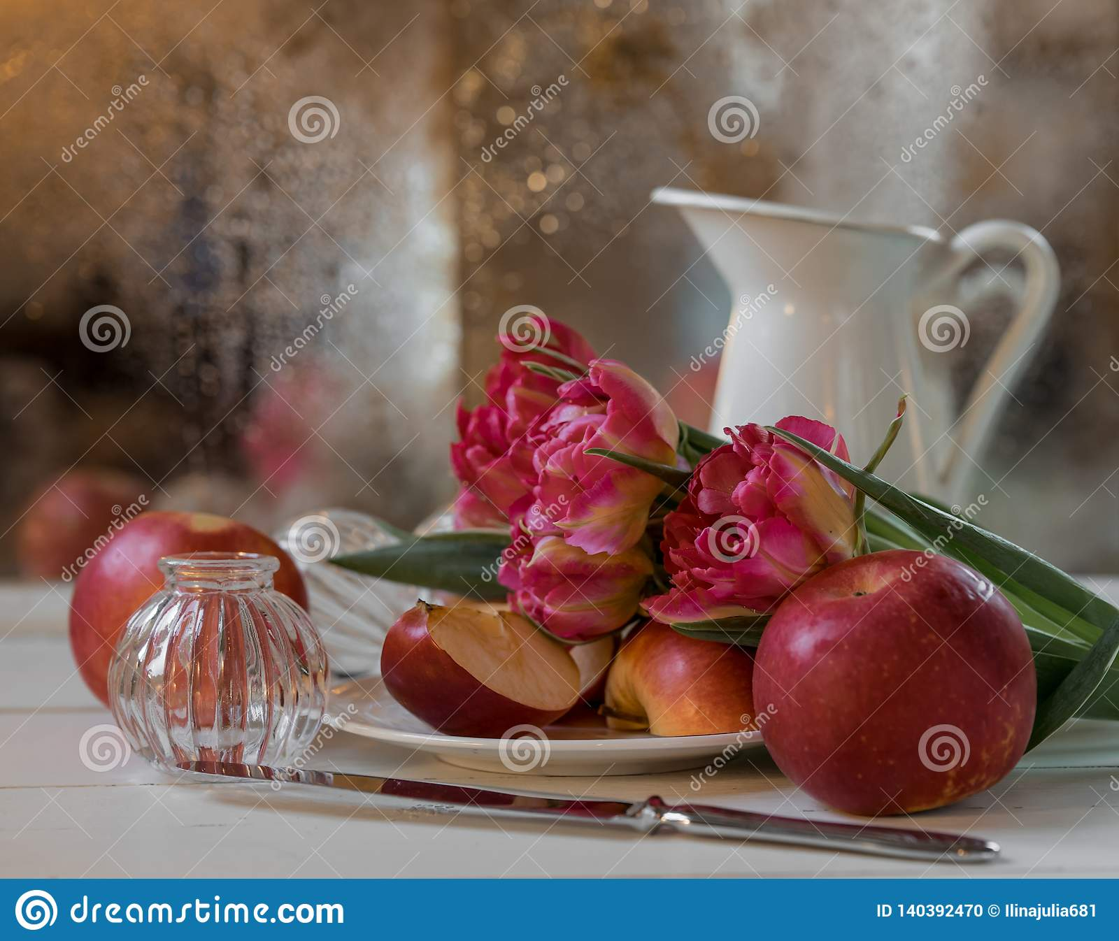 still-life pink flower red apples bokeh background