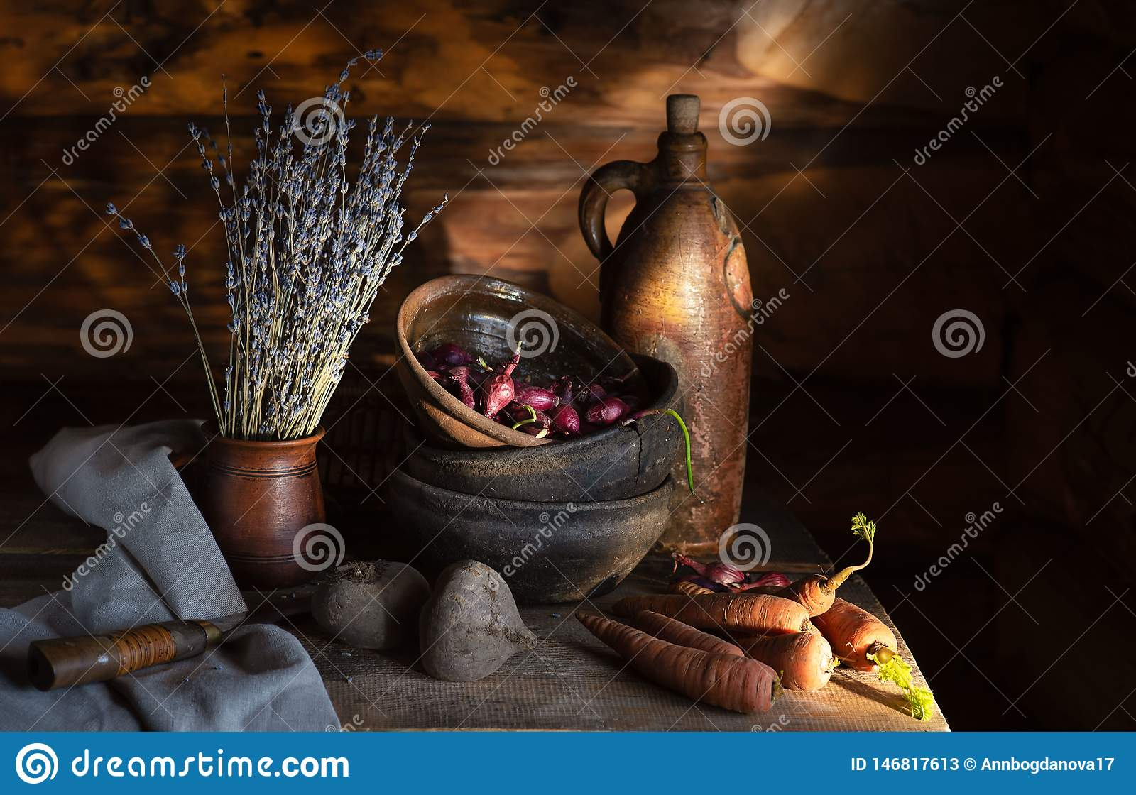 Still life in a village hut. old ceramic dishes and vegetables on the table in the morning sun