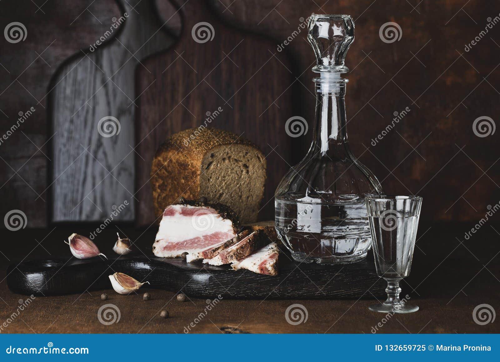 Still life with vodka, bread and lard