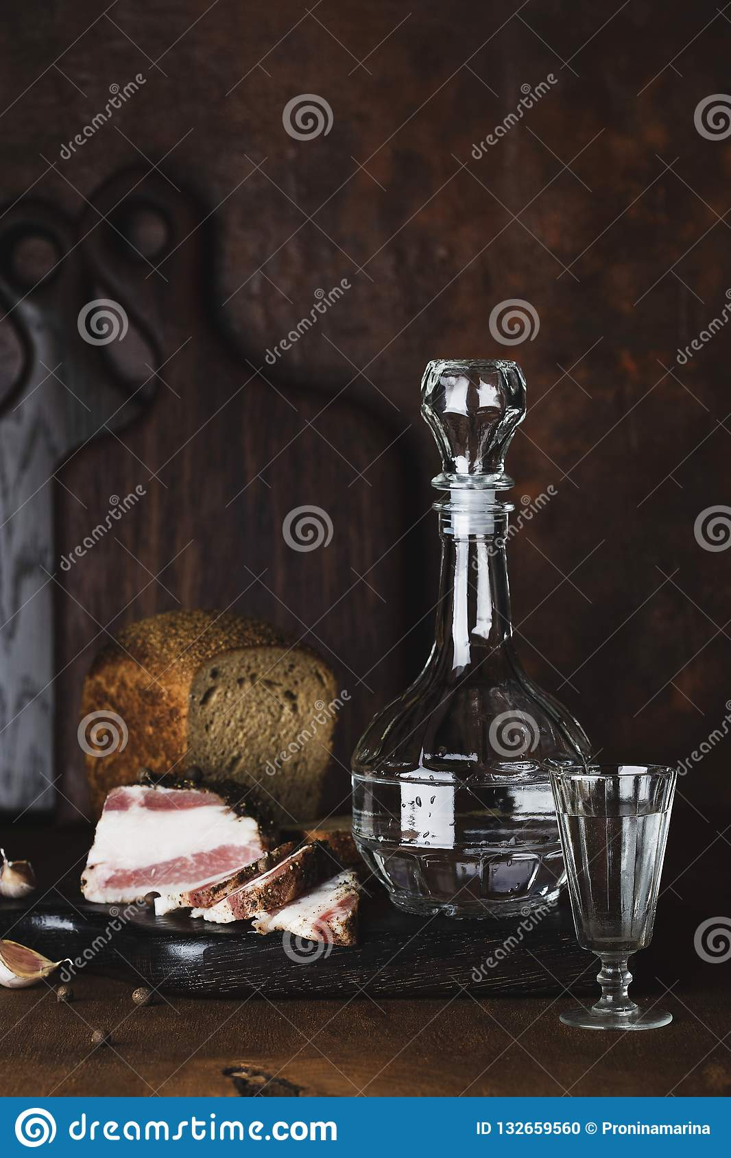 Still life with vodka, bread and lard