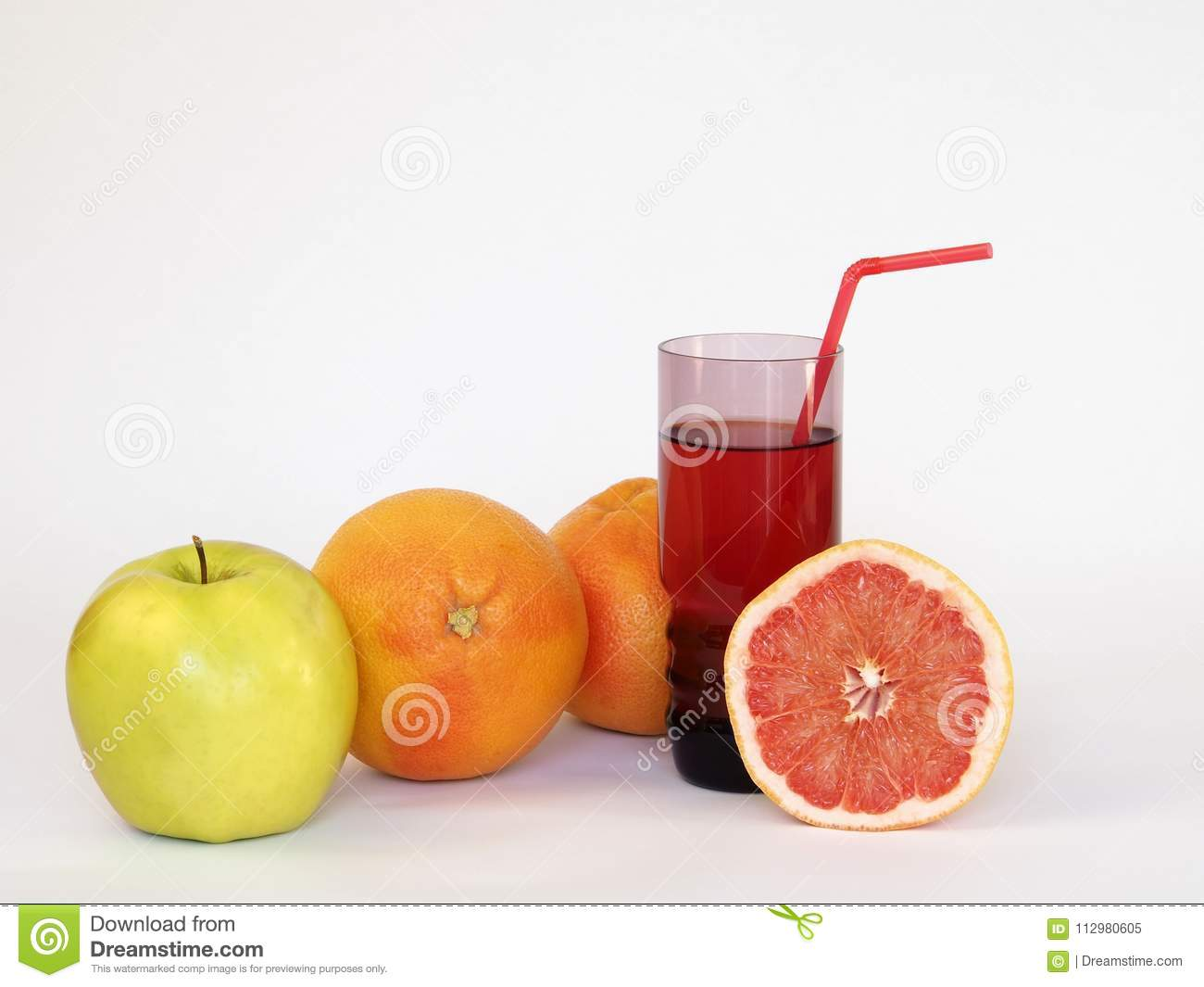 Still life. On the White background are: an apple, two whole grapefruits and a glass of juice, from which sticks out a tube for co