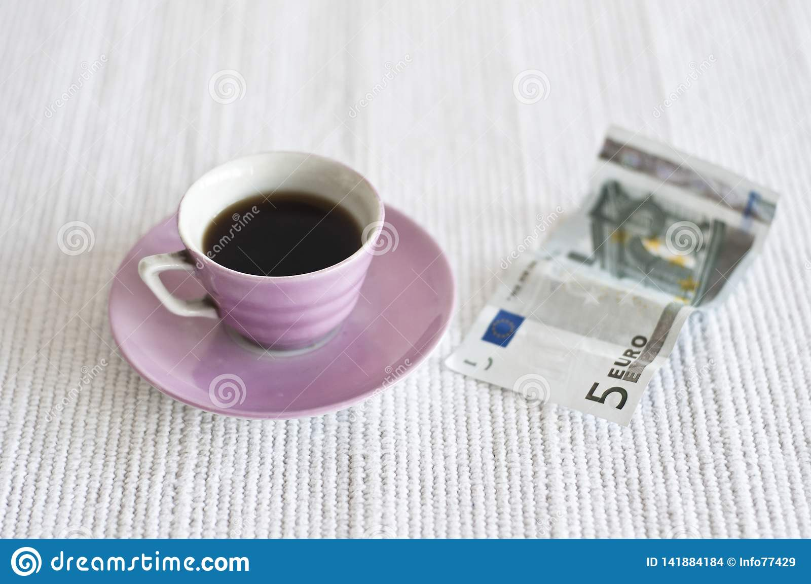 Cup of coffee and 5 euro note
