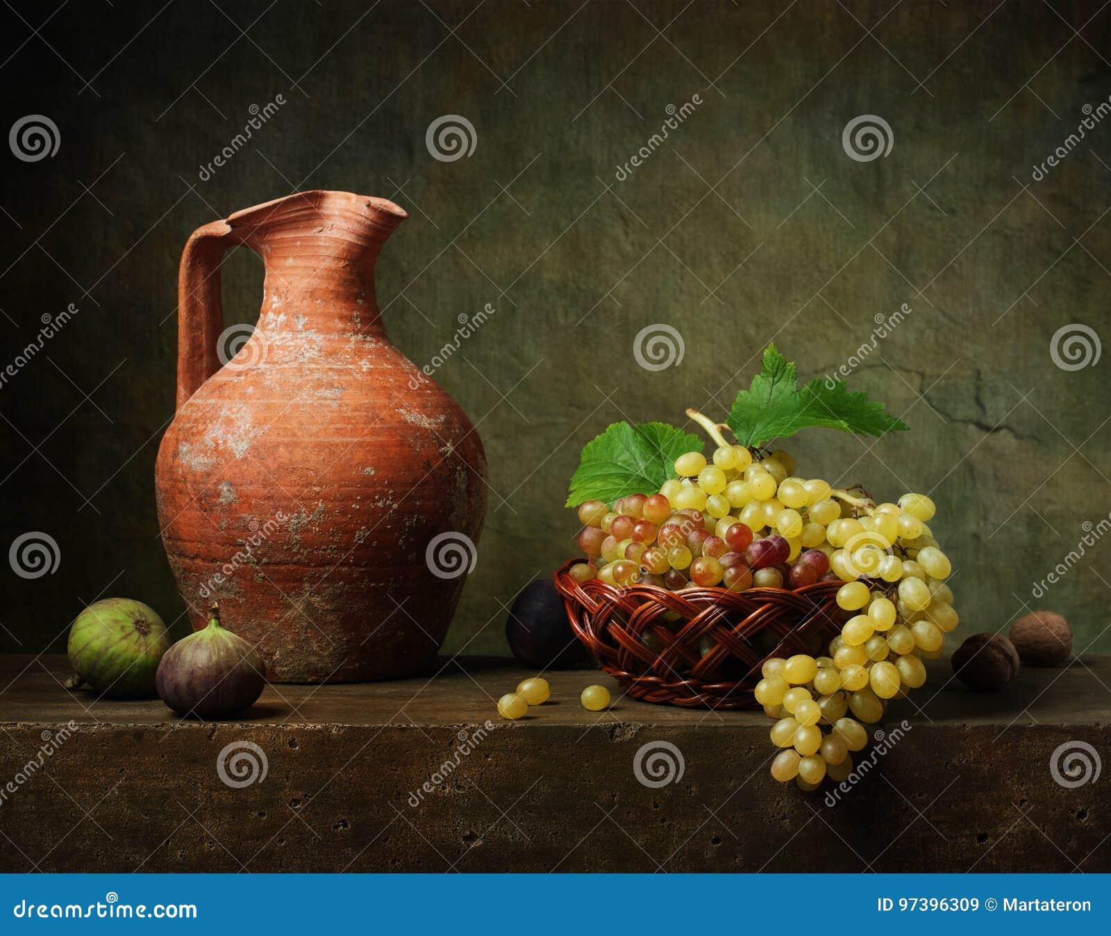 Stilleben med druvor och fikonträd