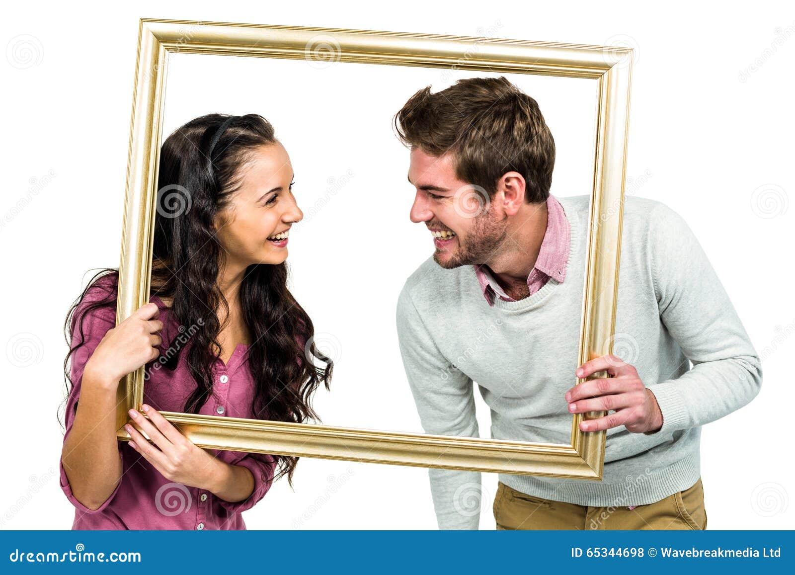 Stilvolle Paare, Die Bilderrahmen Halten Stockfoto - Bild von nähe ...