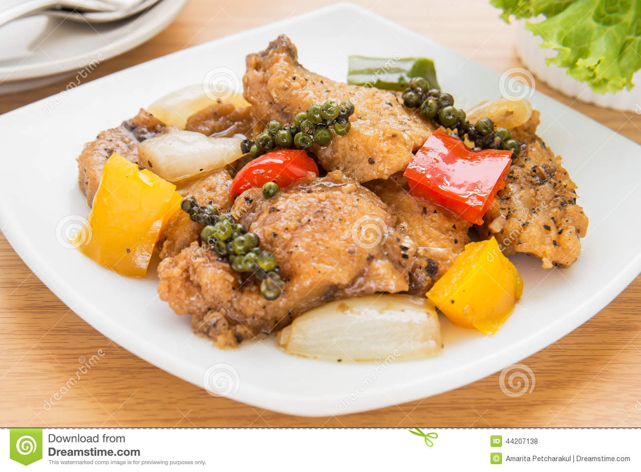 Stir fried fish in black pepper sauce on dish for Fish sauce stir fry