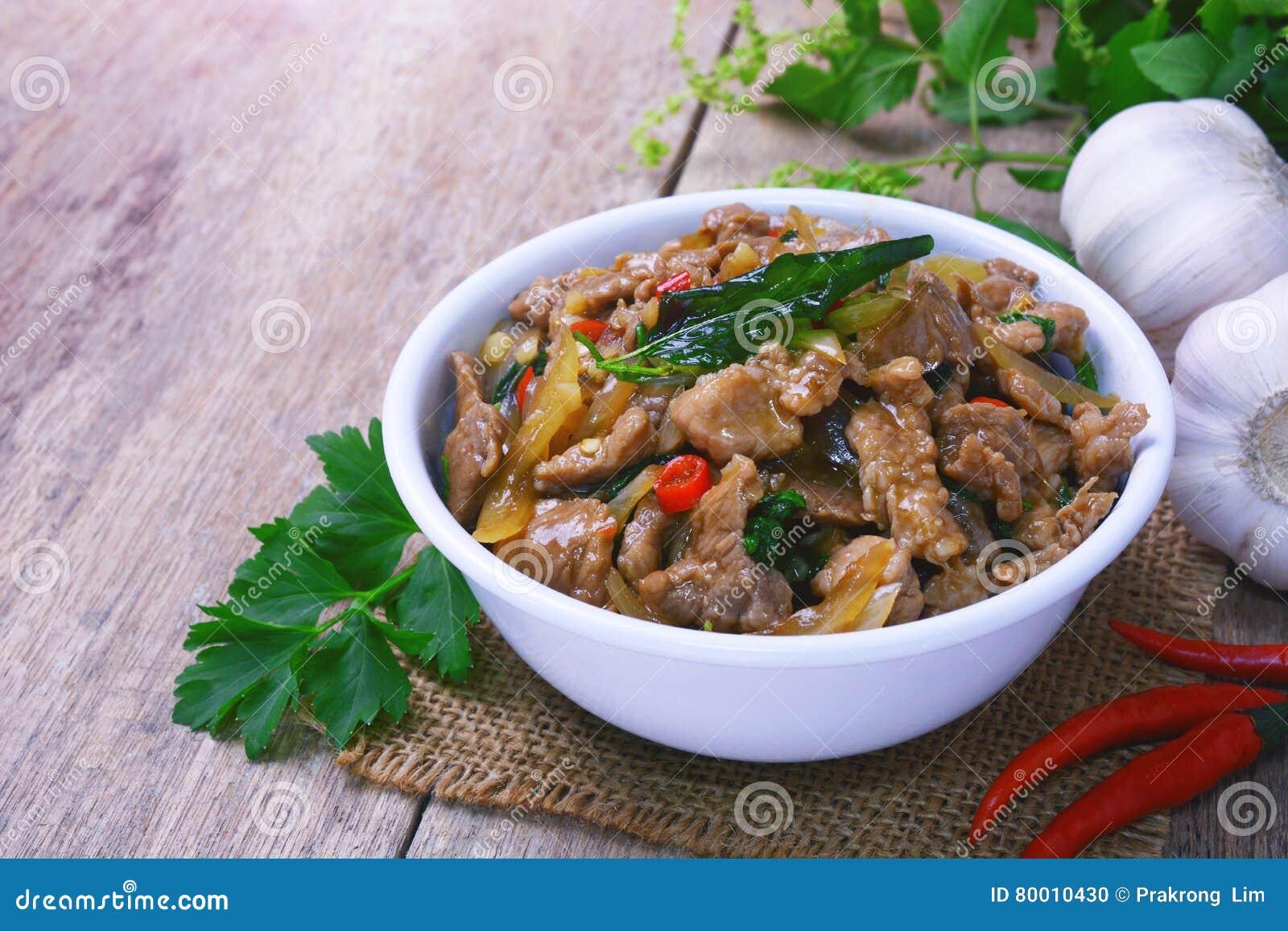 Stir fried hot and spicy sauce with pork, crispy basil leaf on top.