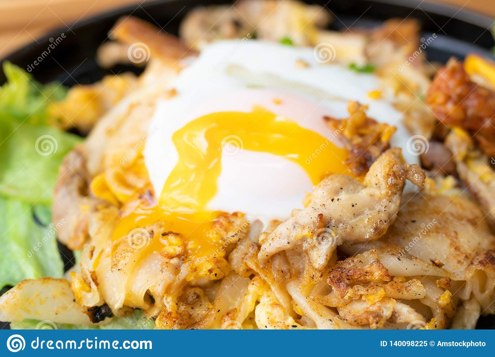 Stir fried noodles with chicken and fried egg Thai food