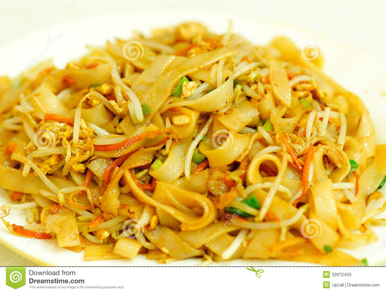 Stir fried rice noodles with egg and vegetables.