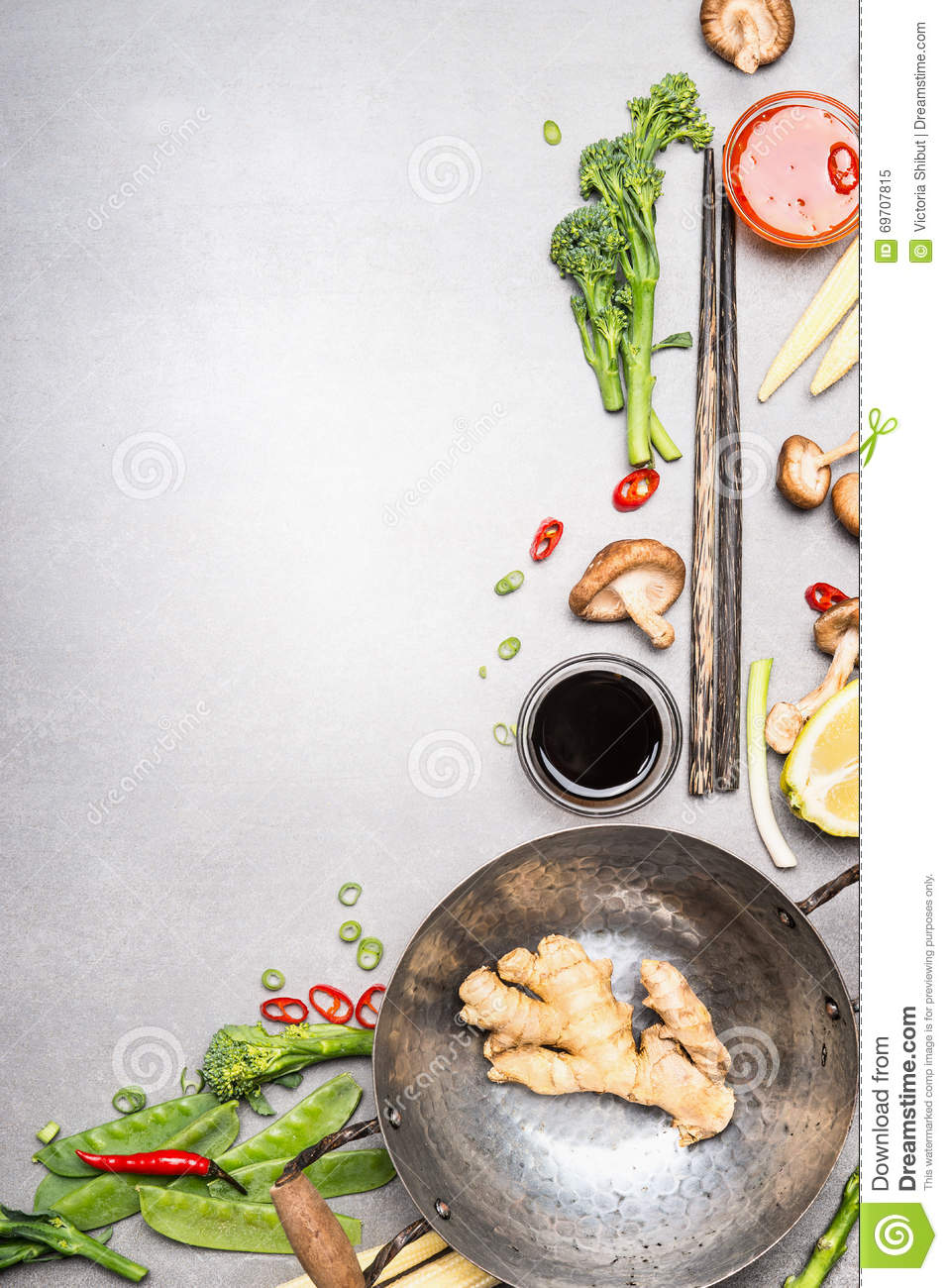 Stir fry ingredients with wok and chopsticks asian for Art cuisine stone cookware