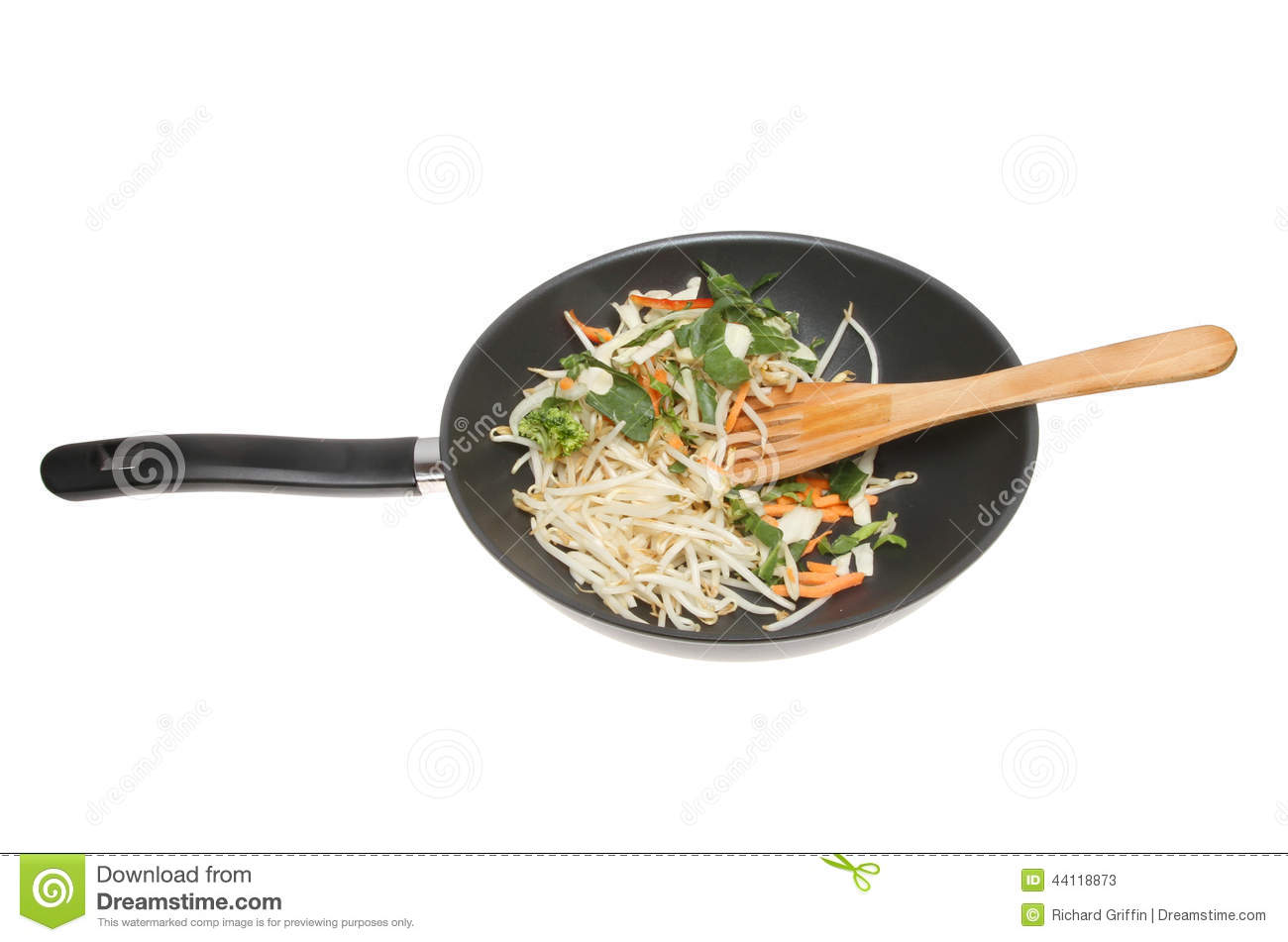 Stir fry vegetables in a wok
