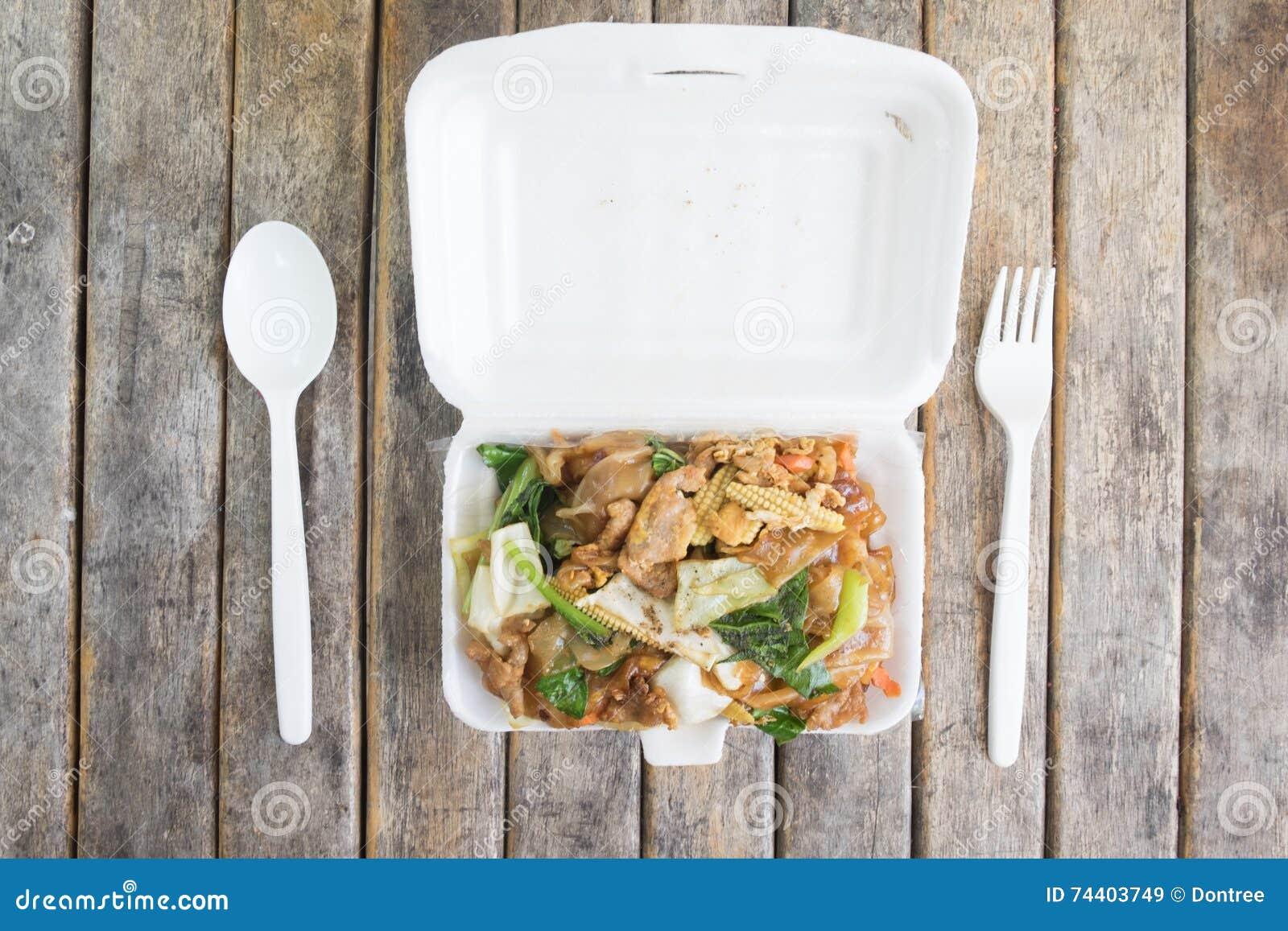Stir soy sauce in foam box