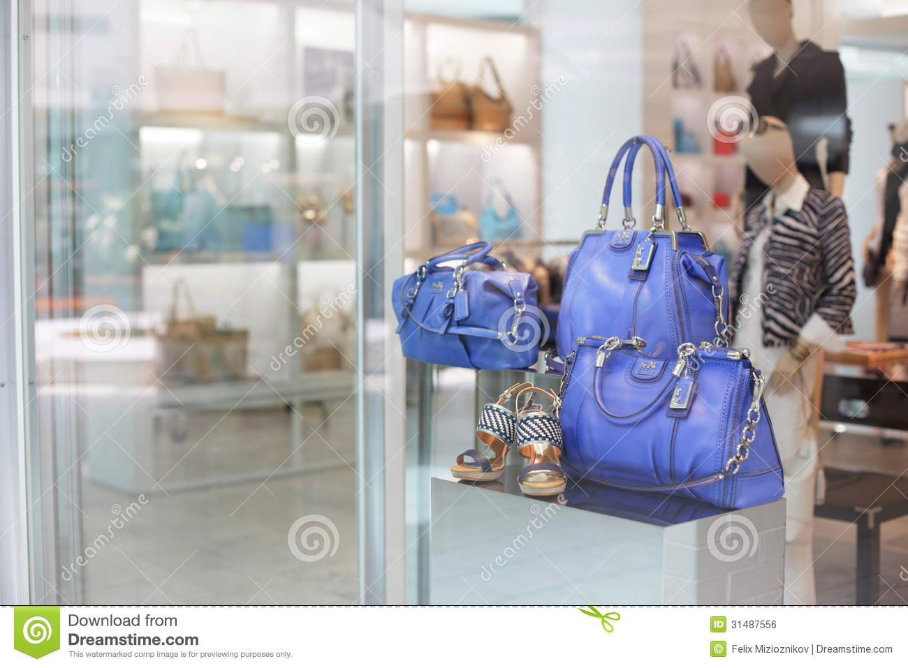 68b9ffccd766 Stock image of Coach leather handbags on display royalty free stock image