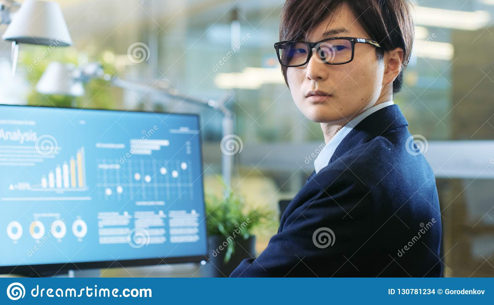 In the Stock Market Firm Office Broker Works with Statistical In