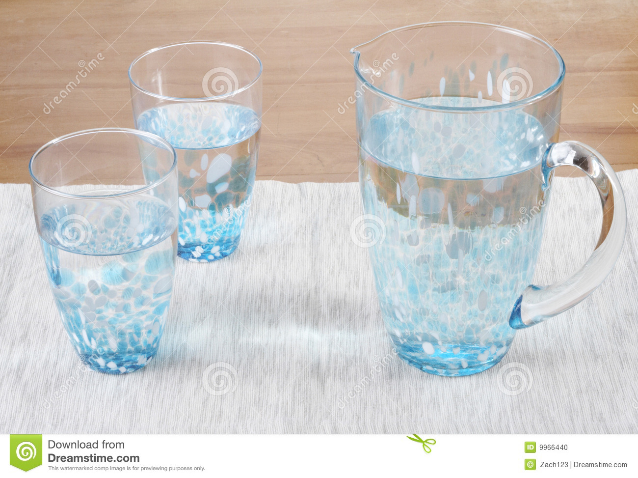 stock photo of two glasses and a pitcher of water stock