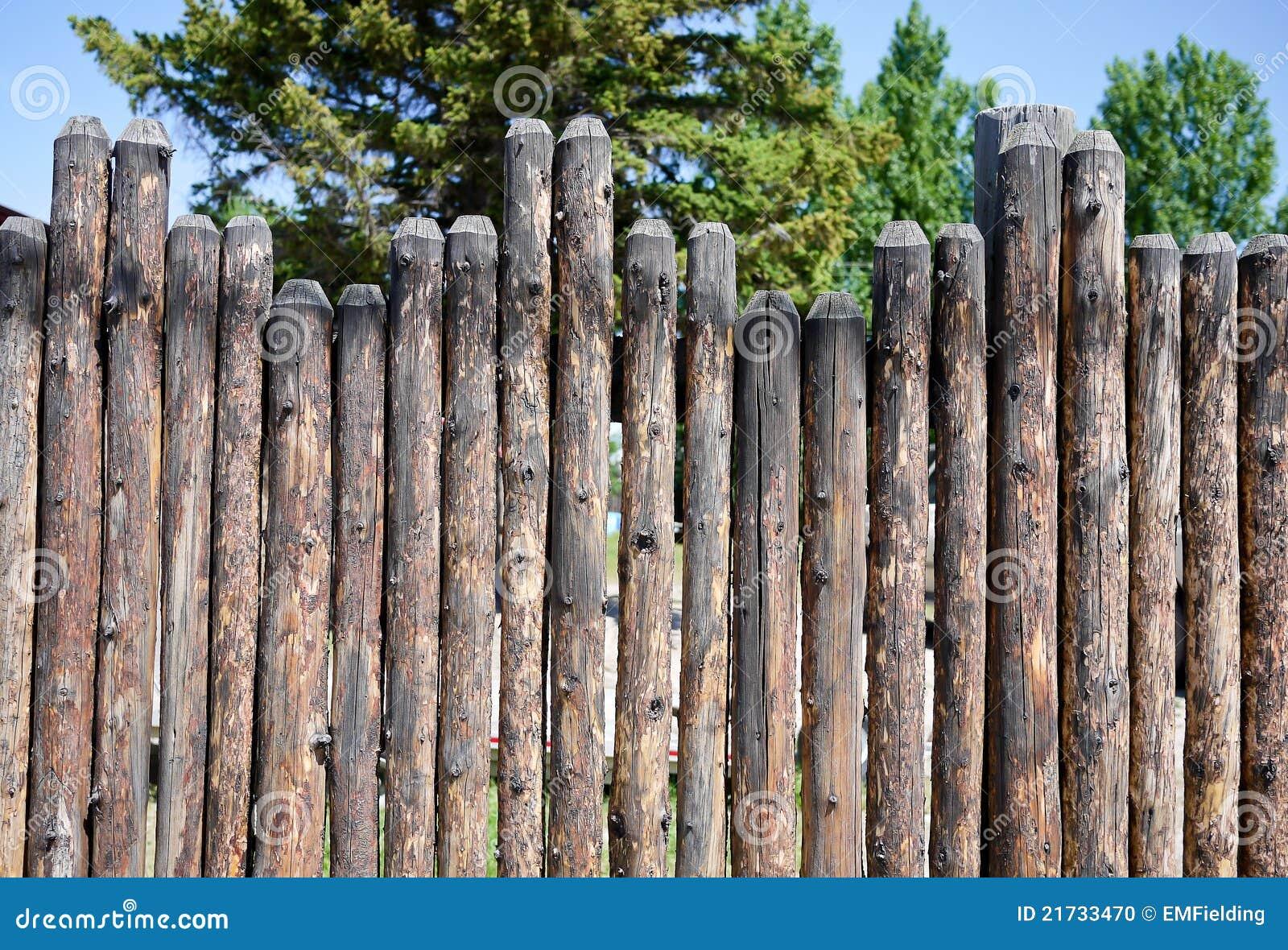 Log Pole Fence ~ Stockade fence stock photo image