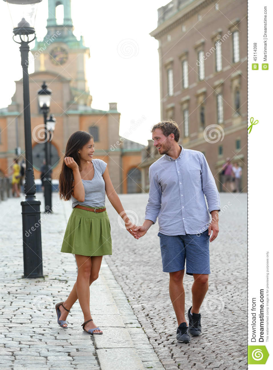Gamla Stand Designs : Stockholm couple walking romantic by royal palace stock