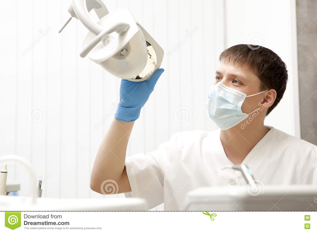 Stomatology concept - happy male dentist at dental clinic office