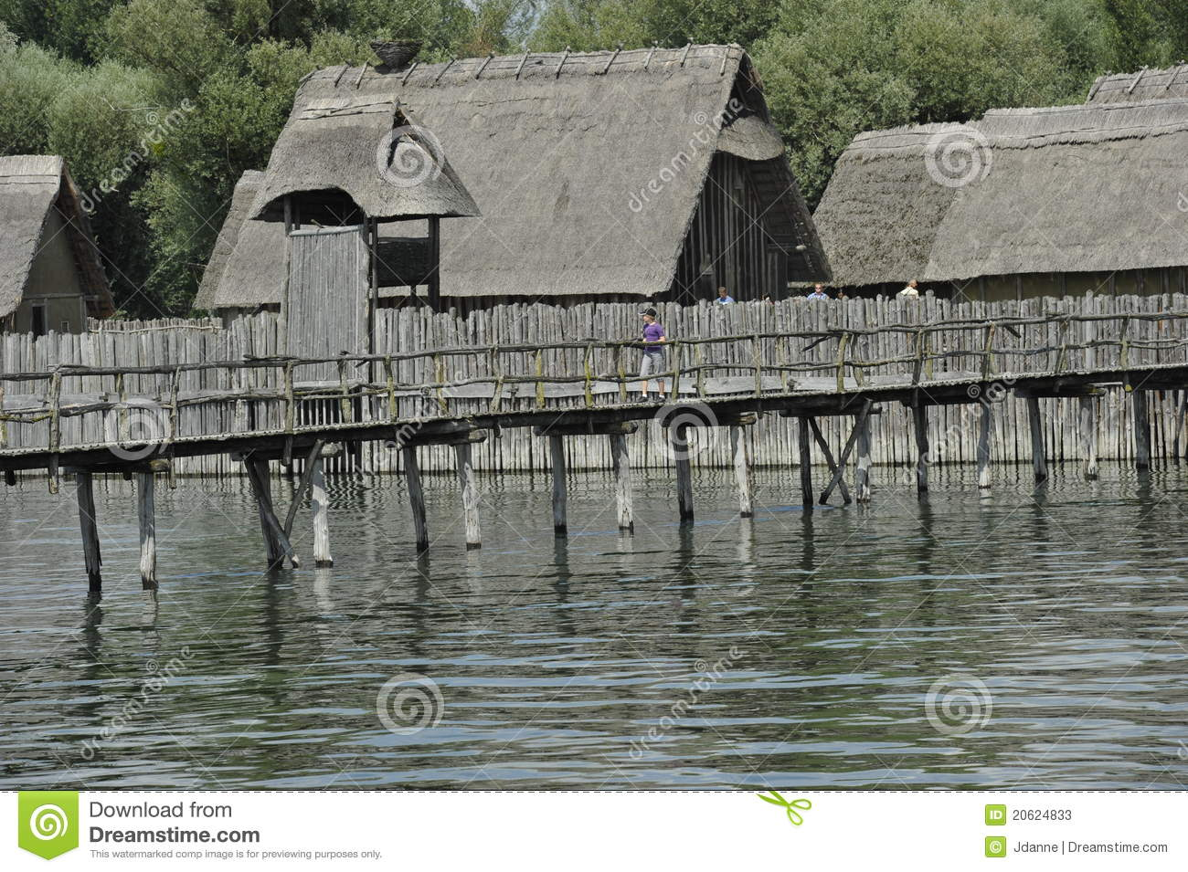 Stone age stilt house village editorial stock photo for Lake house plans on stilts