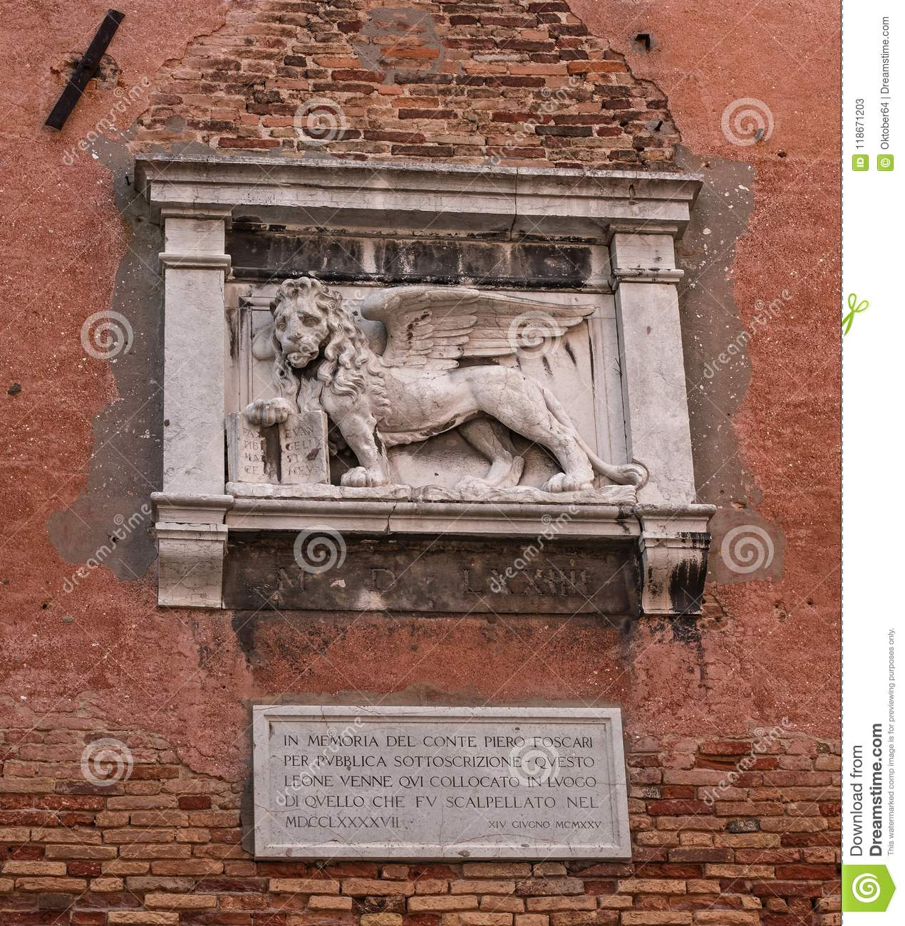 Stone bas-relief of the Venetian lion on the wall of the Arsenal of Venice. The lion of St. Mark is a symbol of the city
