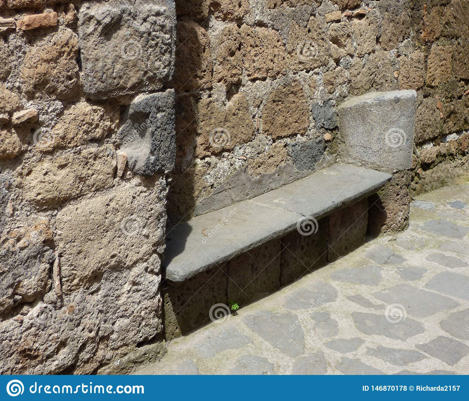 Stone bench in a Tuscan hill town