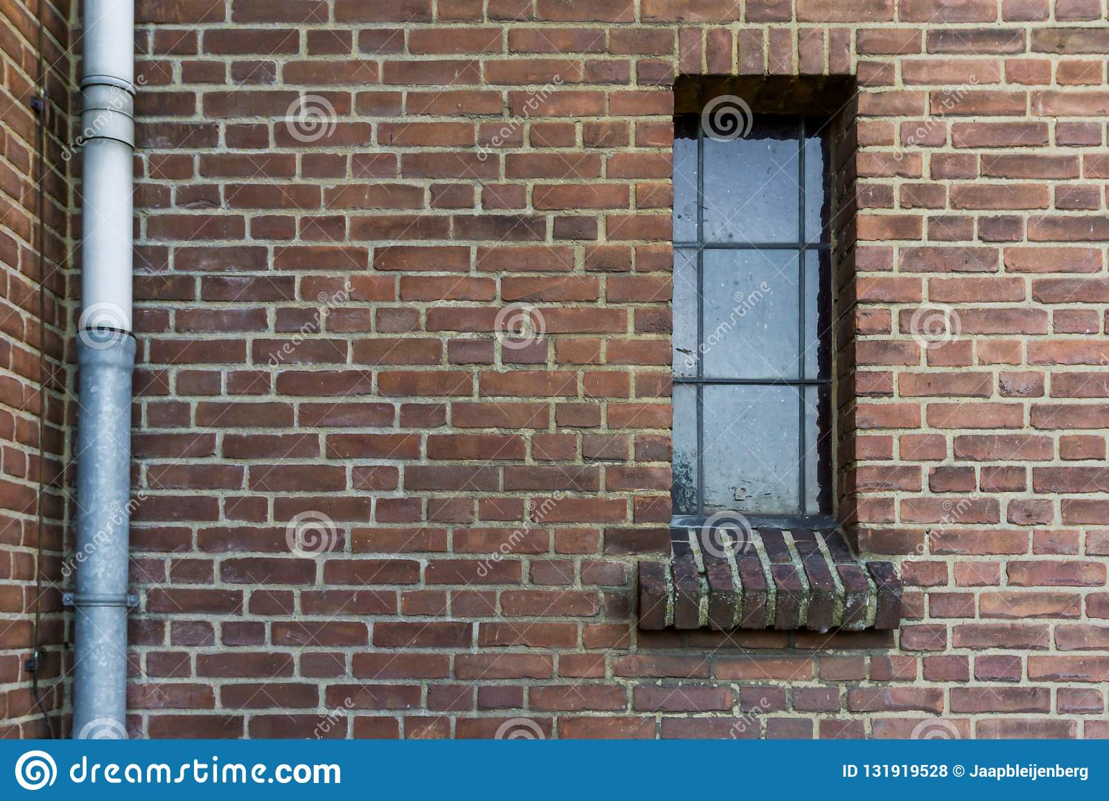 Stone brick wall pattern with a old dirty glass window framework in stained glass retro architecture background
