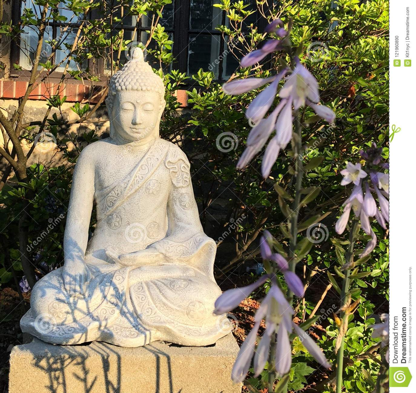 Stone Buddha Statue With Purple Flowers