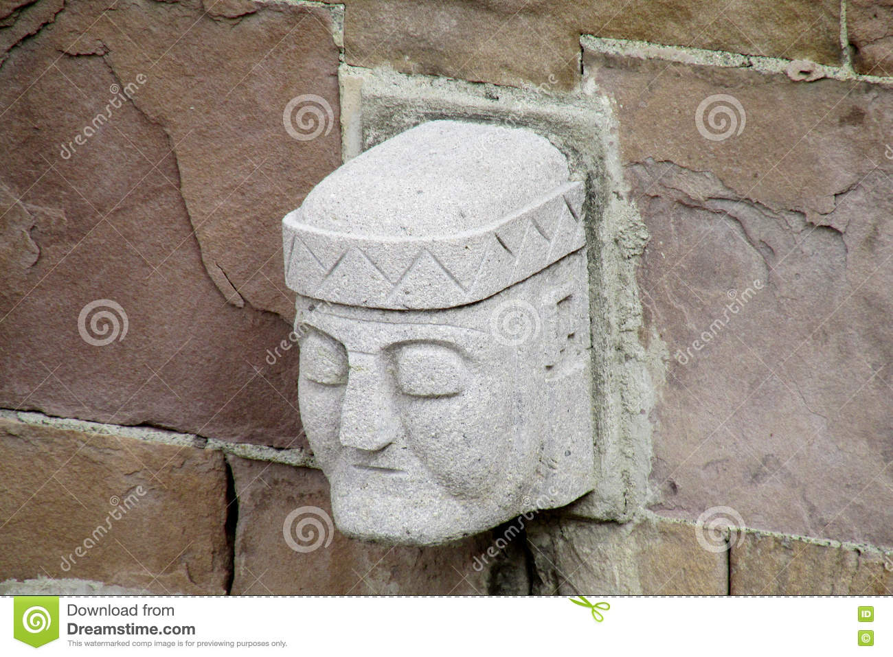 Stone carving face from tiwanaku archaeological site stock