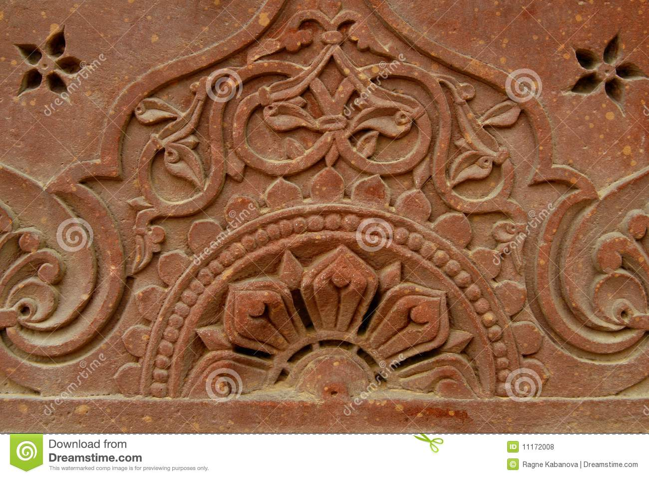 Stone carvings on the temple wall india royalty free