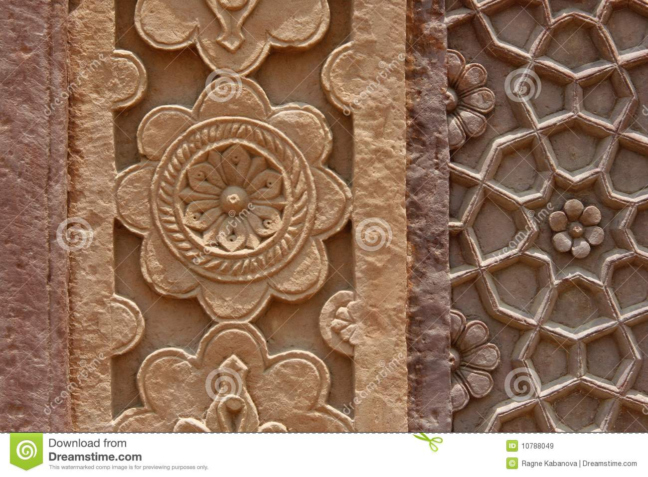 Stone carvings on the wall of a temple in india stock