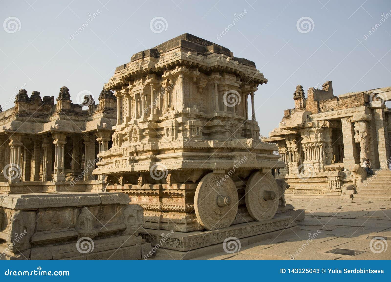 Stone chariot in courtyard of Vittala Temple at sunset in Hampi, Karnataka, India