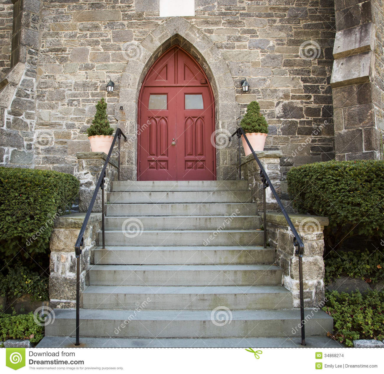 Steps lead up to a red door on this old stone church in Greenwich, CT.