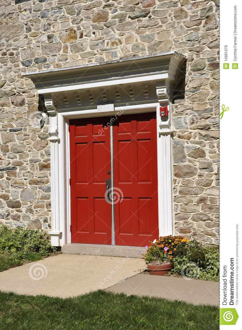 Red Doors Stone : Stone church and red doors royalty free stock images