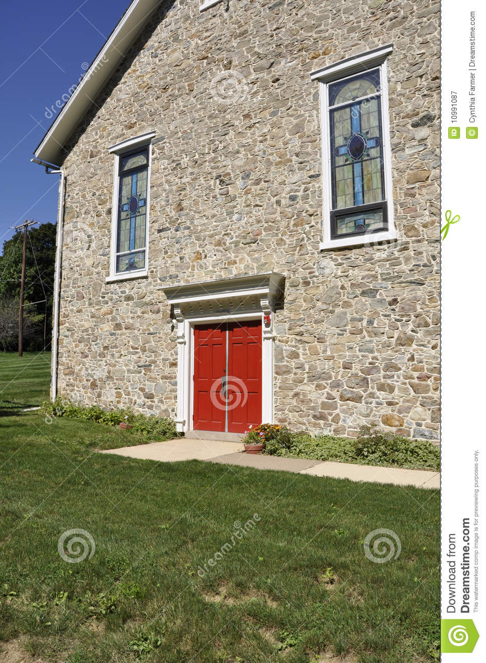 Red Doors Stone : Stone church with red doors stock image