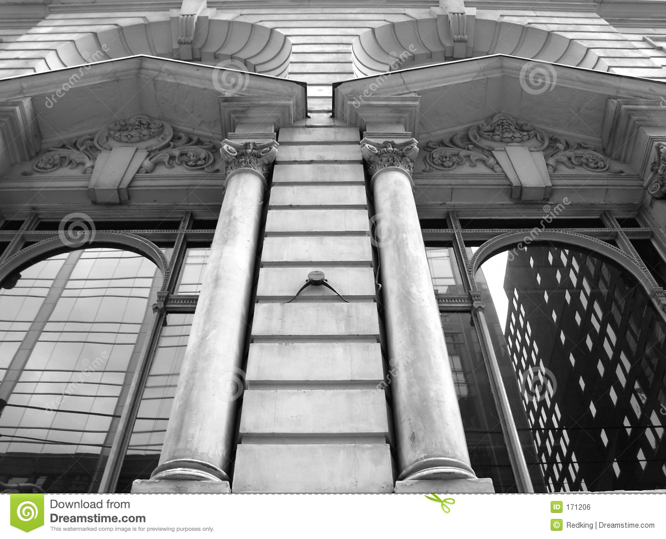 Stone Columns with windows that reflect the city