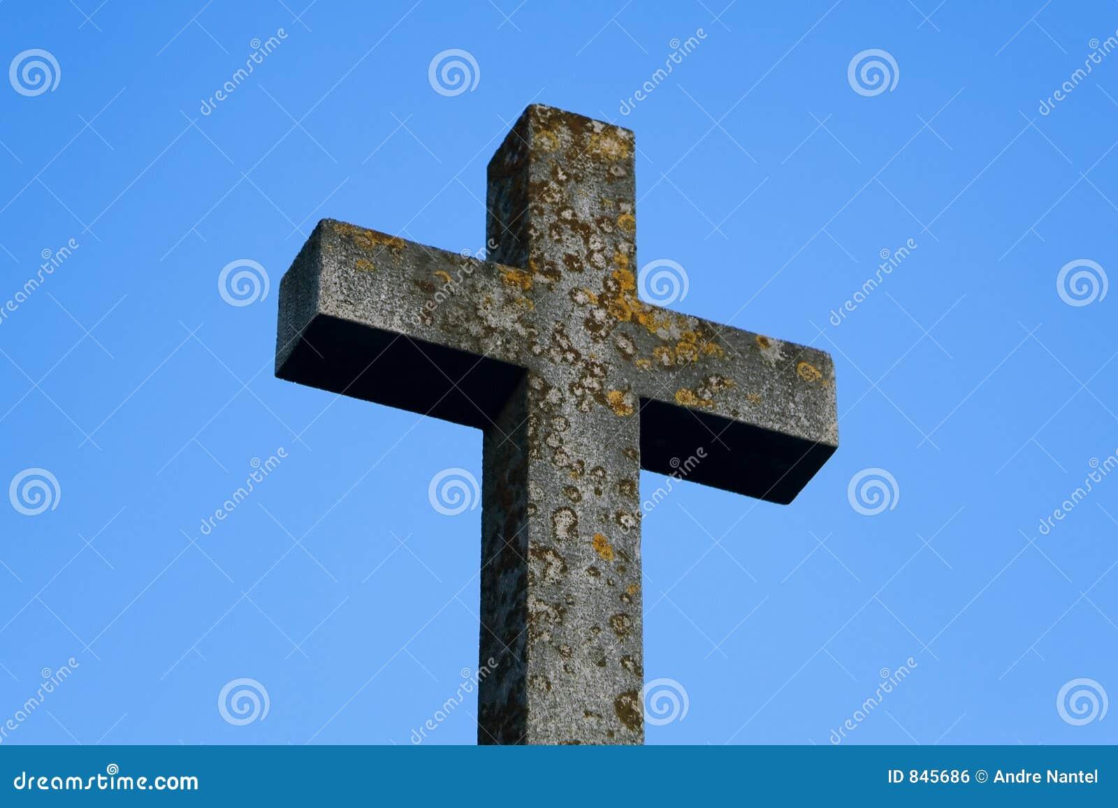 Stone Cross under Blue Sky