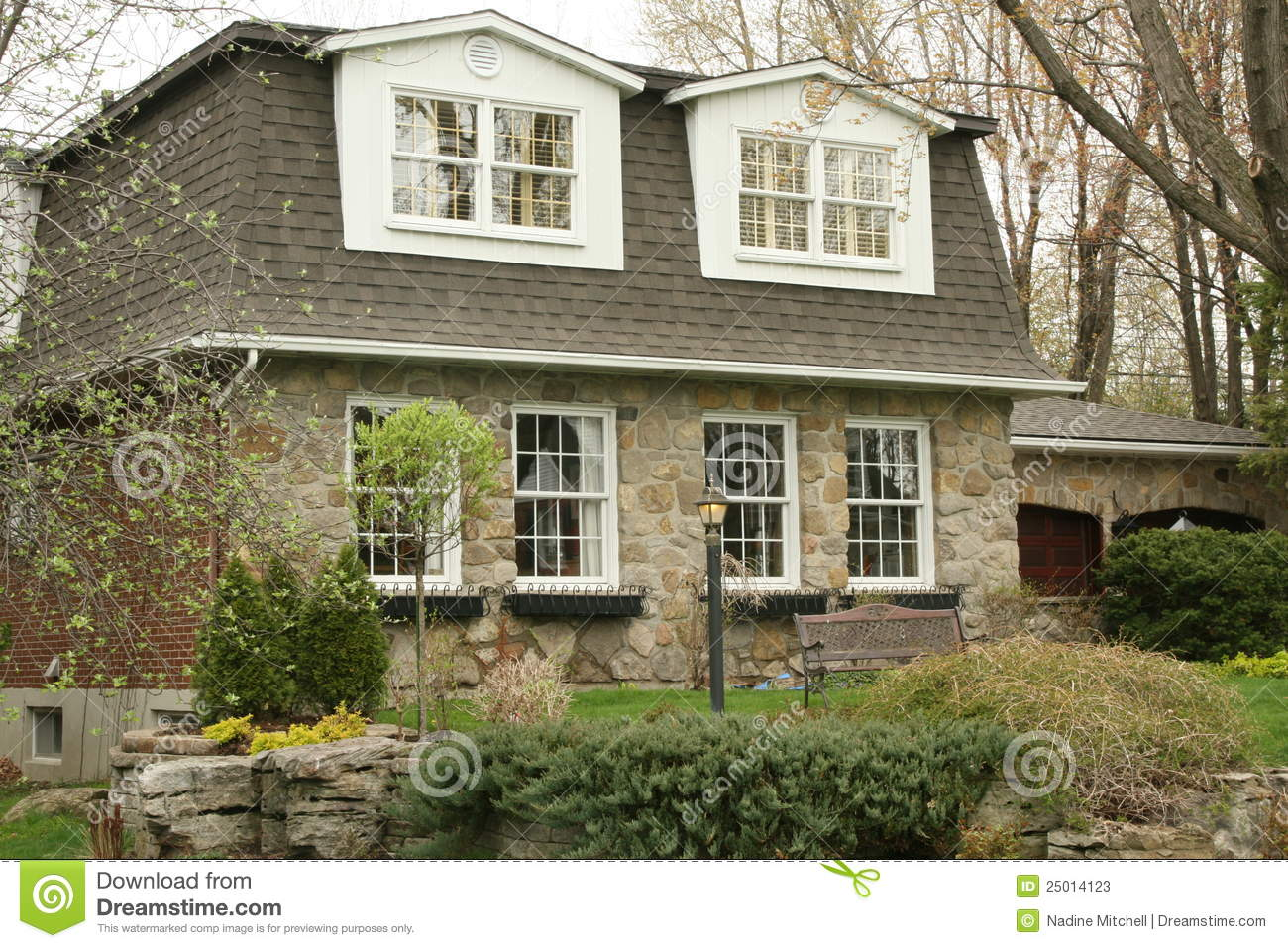 Stone Executive Cottage With Mansard Roof Stock Image