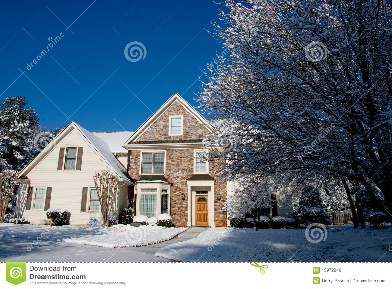 Stone faced house with snow and blue sky royalty free for Stone faced houses