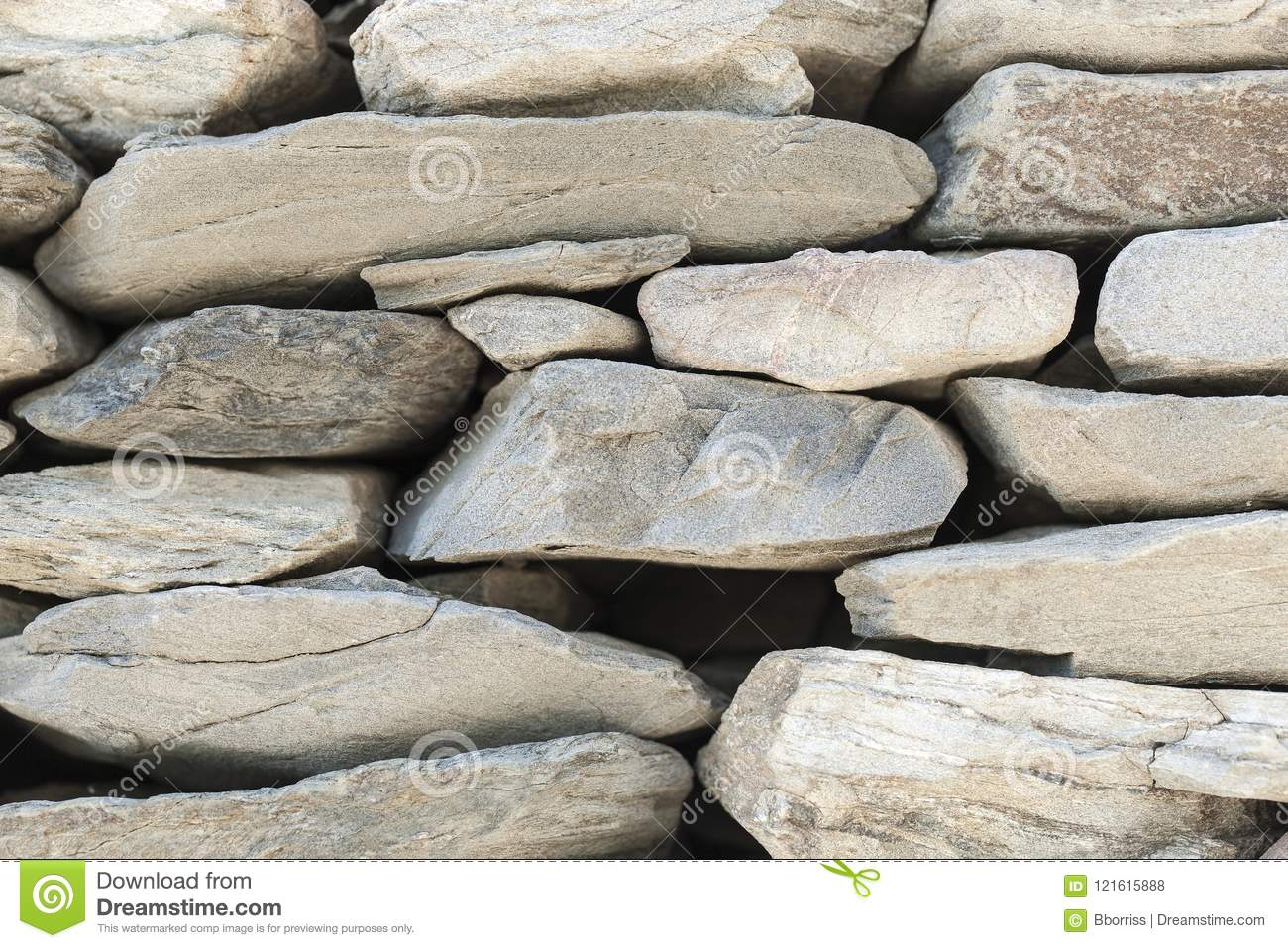 The stone fence of solid pieces of stone