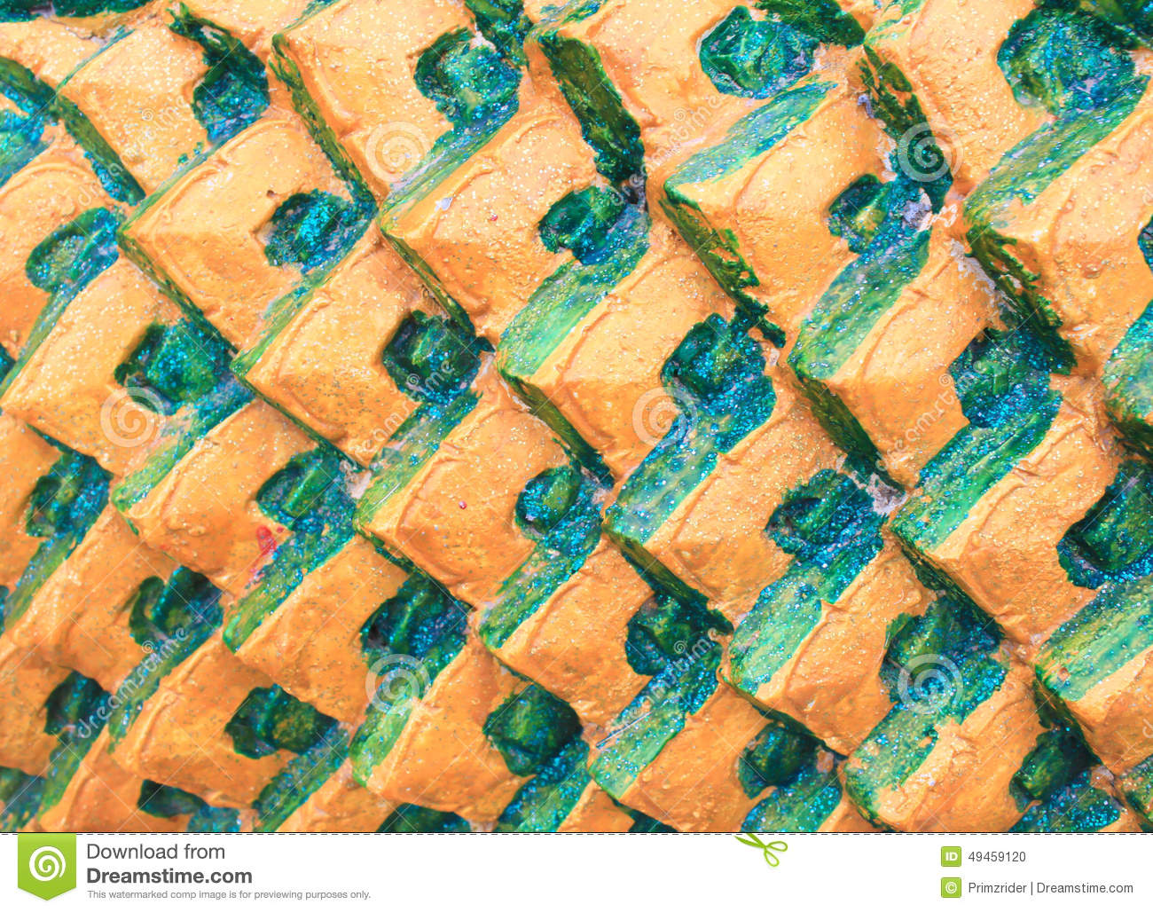 Stone fish scales decorate stock photo image of rock
