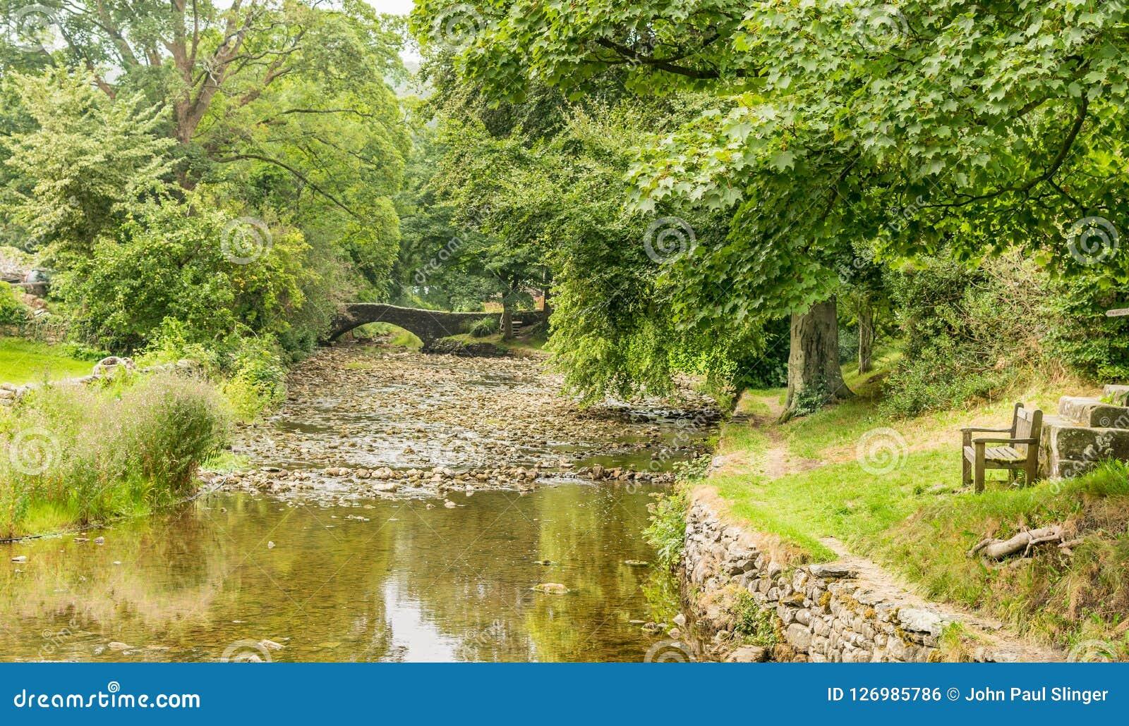 A stone humpback bridge over a river