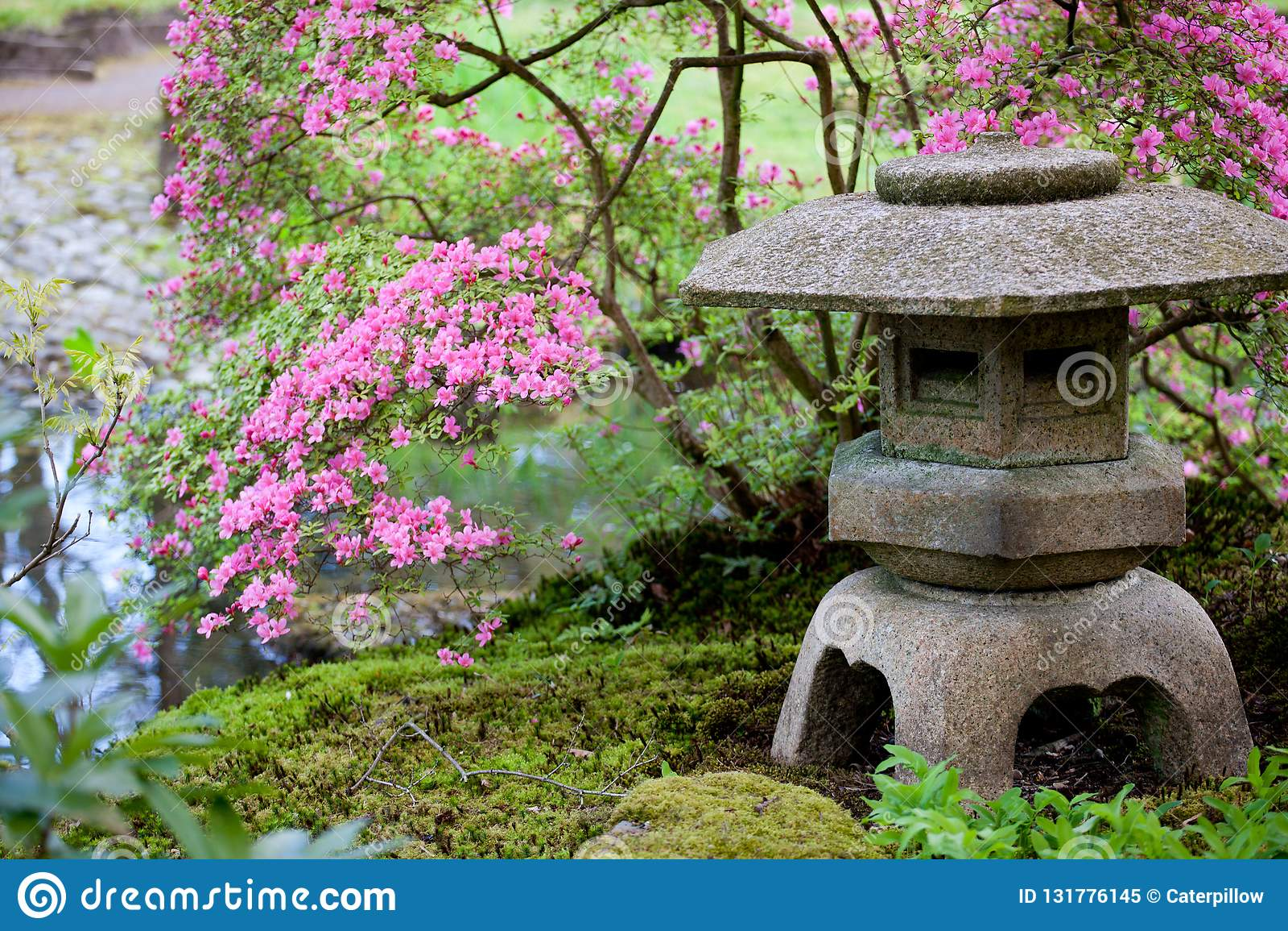 Stone Japanese Lantern In A Traditional Oriental Garden Stock